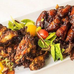 Yah Mon Caribbean Restaurant Amazing Bone in Wings Jerk Honey BBQ and Smoked